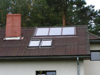 Solar collectors installed in the roof of a private house in Jaunciems
